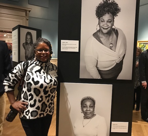 Photographer Penelope Carrington (Petite Shards Productions) and some of the exhibit panels
